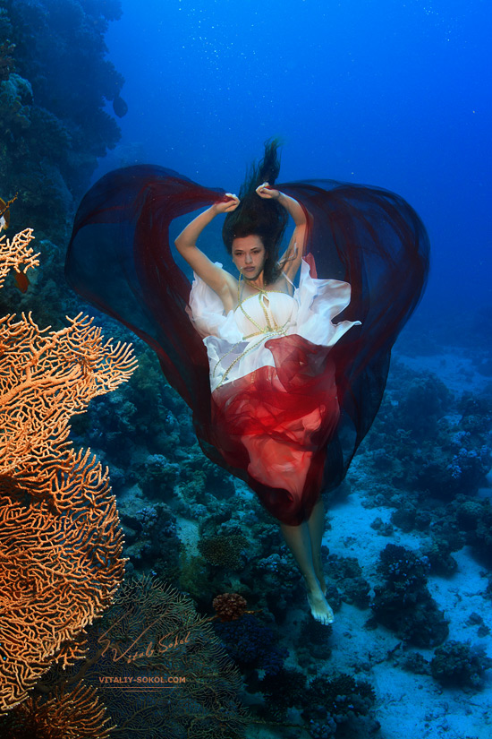 Underwater beautiful model with shape of heart