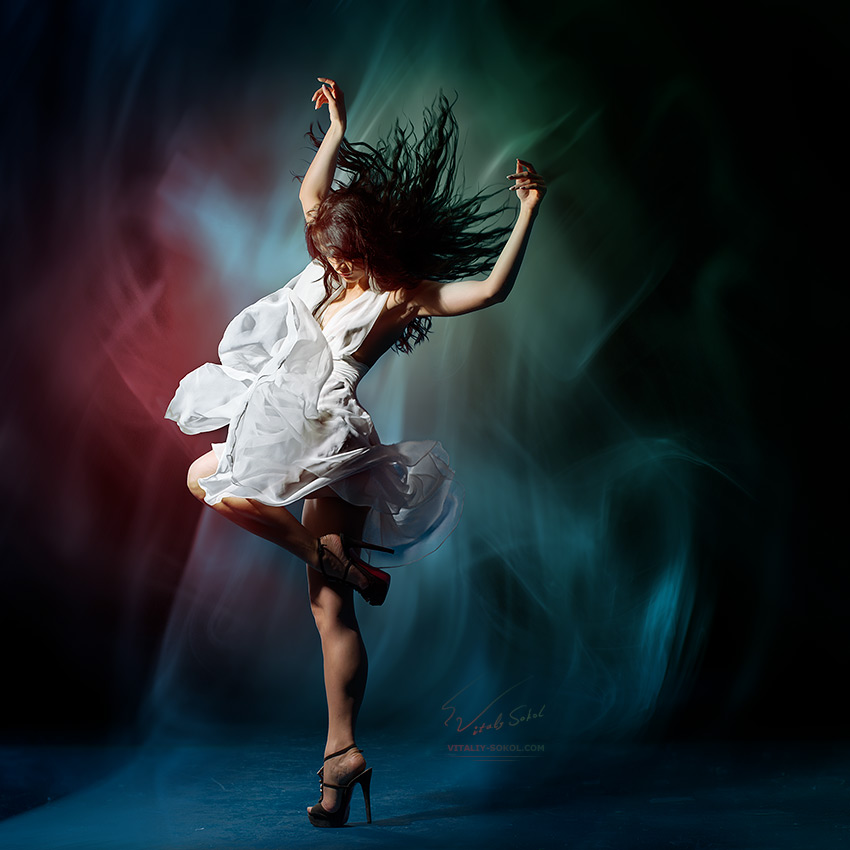 Young dancing with expression girl wearing gorgeous white dress