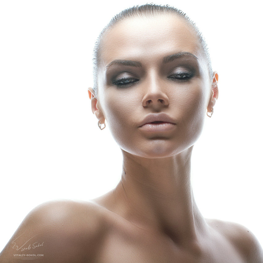 Isolated Beauty Portrait of attractive young model in high-key technique