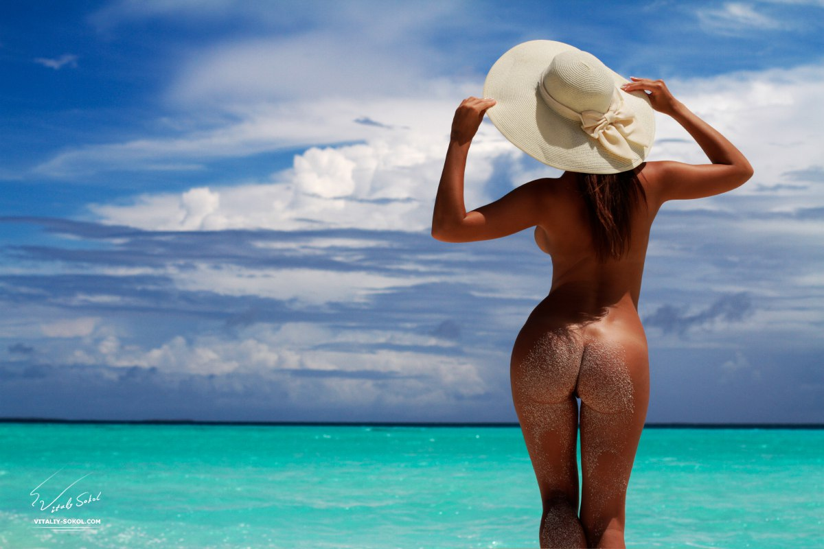 Beautiful Naked Brunete in water at maldivian beach